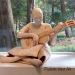 """""""The Guitarist""""   Plaster on Armature/shellack/oil paint – 23""""W, 22""""D, 26""""H  – $1,500.00"""